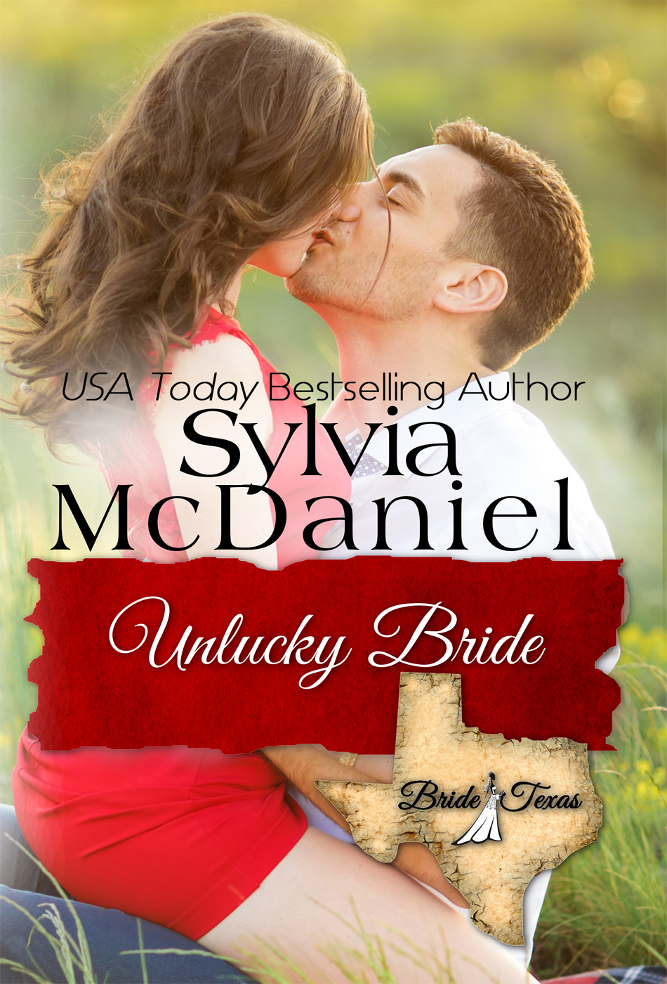 Cover of the Unlucky Bride by Sylvia McDaniel. A brunette straddling a handsome man and kissing him.